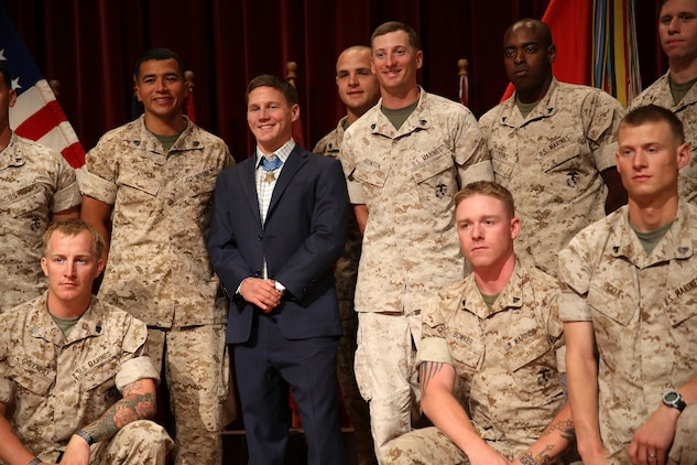 "Medal of Honor recipient Cpl. William ""Kyle"" Carpenter visited Marines on Camp Pendleton, June 23. Carpenter met and talked with Marines at the base theater, answering their questions and sharing his personal experience. Carpenter then met and took photos with units from across Camp Pendleton. 