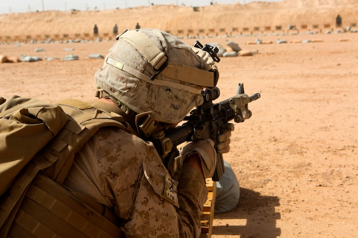 Lance Cpl. Jonathan Hance, a machine gunner with 1st Battalion, 2nd Marine Regiment, fires his rifle during a combat marksmanship range held aboard Camp Leatherneck, Helmand province, Afghanistan, June 20, 2014. Ranges such as this one keep Marines like Hance, a Hickory, N.C., native, on top of their shooting skills and give them the confidence they need while on a patrol. (U.S. Marine Corps photo by Cpl. Michael Dye/released)