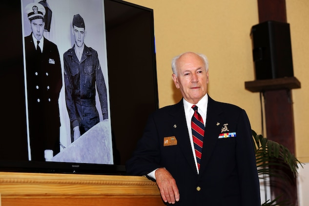 """John R. Caruso reminisces about his brother's life and service after viewing a photo of him, Sgt. Matthew Caruso, at the rededication of the Caruso Chapel, located at the School of Infantry-West, here, June 23.  The chapel was initially dedicated to Caruso in 1953 and he was awarded the Silver Star Medal in 1950 for shielding Connie Griffin, a chaplain then assigned to the 7th Marine Division (reinforced), from enemy fire with his body during an ambush in the Korean War, Dec. 6, 1950.  """"There went a father, a husband, a brother, and it affected a lot of people."""" John said with tears in his eyes. """"He was a good brother, but [this is] something Marines do."""""""