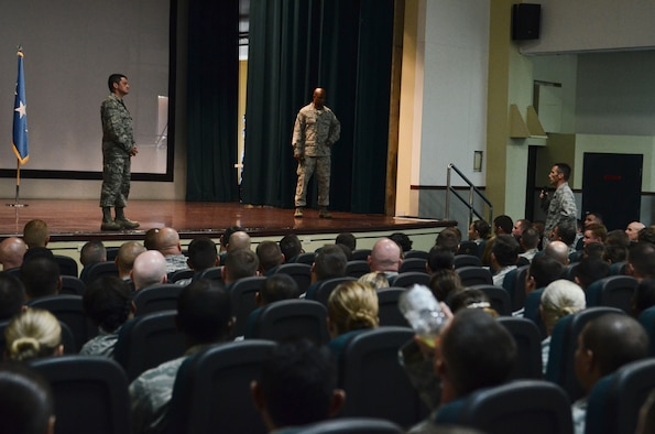 (Right) Lt. Col. Steve Harrold, 36th Operations Group deputy commander, asks Lt. Gen. Russell Handy, 11th Air Force commander, a question during an all call June 19, 2014, on Andersen Air Force Base, Guam. Handy took the opportunity to address Andersen's Airmen following the 36th Wing change of command. (U.S. Air Force photo by Airman 1st Class Emily A. Bradley/Released)