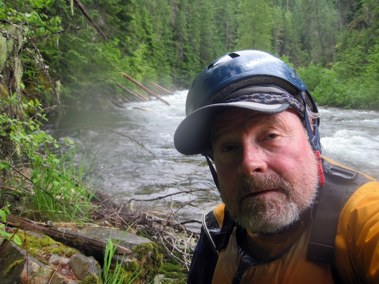 Bart Rayniak gets rescued by Airmen from Fairchild Air Force Base, Wash., when he was kayaking where Marble Creek flows into the St. Joe's River, Wash., June 13, 2014. Rayniak was kayaking when his board flipped over, ejecting him into the cold water. (Courtesy photo)