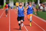 Air Force wounded warriors, Nicholas Dadgostar, foreground, and Gideon Conelly, race in the 100 meter track event during Warrior Games trials at the U.S. Military Academy at West Point, N.Y., June 17, 2014.