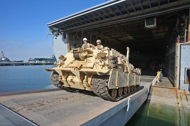 An M88 recovery vehicle operated by Marines with Combat Logistics Battalion 15, Combat Logistics Regiment 15, 1st Marine Logistics Group, climbs a ramp aboard amphibious transport dock ship USS New Orleans (LPD-18) during an embarkation operation in support of a Defense Support of Civil Authorities  training exercise aboard Naval Base San Diego, Calif., June 19, 2014. During DSCA operations, the Navy-Marine Corps team can provide local authorities with timely support, allowing them to send aid to areas in the United States where the infrastructure might be damaged beyond the local authorities' capabilities. CLB-15 provides a wide array of capabilities during a DSCA operation, from resupplying forward areas with the Medium Tactical Vehicle  Replacement, to recovering wreckages during disaster relief operation with the M88 recovery vehicles and the Logistics Vehicle Systems.