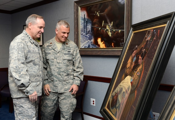 """Air Force Chief of Staff Gen. Mark A. Welsh III looks at the painting, """"Bandage 33,"""" June 20, 2014, with the artist, Maj. Warren Neary, in the Pentagon. Neary, a U.S. Air Force Reserve historian, contributed """"Bandage 33"""" and another work, titled """"Showtime,"""" through the Air Force Art Program. (U.S. Air Force photo/Scott M. Ash)"""