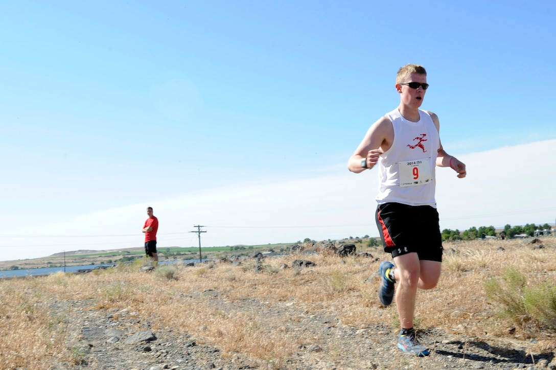 Dallas Croft begins a 3.1-mile semi-cross country run during the 4th Annual iTri at Strike Dam, Idaho, June 21, 2014. During the competition, participants completed a swimming, cycling and running challenge. (U.S. Air Force photo by Senior Airman Caitlin Guinazu/Released)