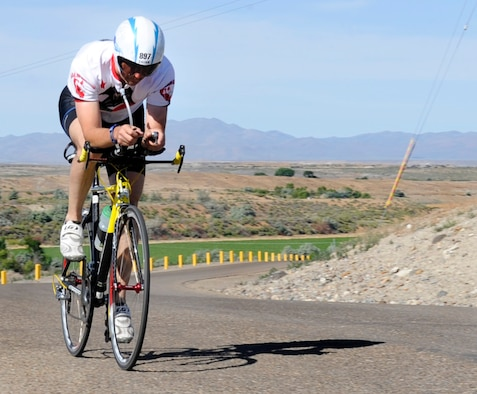 Maj. Kenneth Shinn, 366th Component Maintenance Squadron commander and 1st place recipient in the male category, completes a 12.4-mile bike ride during the 4th Annual iTri at Strike Dam, Idaho, June 21, 2014. The competition included a 300-meter swim, 12.4-mile bike ride and a 3.1-mile run. (U.S. Air Force photo by Senior Airman Caitlin Guinazu/Released)