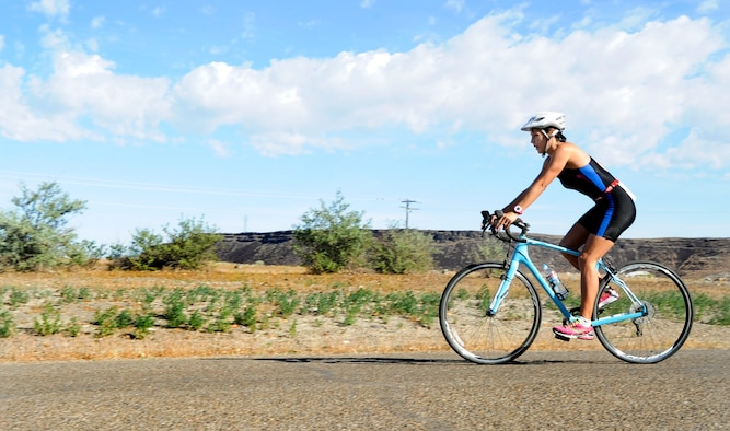 Veronica Ballek, 2nd place in the women's category, begins the 12.4-mile bike ride during the 4th Annual iTri at Strike Dam, Idaho, June 21, 2014. The beginner triathlon appealed to all fitness levels and allowed participants to compete as individuals or as a team. (U.S. Air Force photo by Senior Airman Caitlin Guinazu/Released)