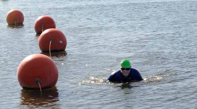 A participant completes the swimming portion of the 4th Annual iTri at Strike Dam, Idaho, June 21, 2014. In conjunction with swimming, participants also competed in cycling and running events. (U.S. Air Force photo by Senior Airman Caitlin Guinazu/Released)