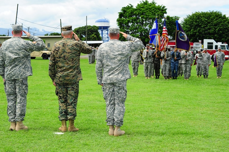 U. S. Army Col. Kirk C. Dorr (left), U. S. Marine Gen. John F. Kelly, U. S. Southern Command commander, and U. S. Army Col. Thomas D. Boccardi salute the Honduras and American flag during the Joint Task Force-Bravo change of command ceremony at Soto Cano Air Base, Honduras, June 23, 2014. Col. Dorr assumed command from Col. Boccardi.  (Photo by U. S. Air National Guard Capt. Steven Stubbs)