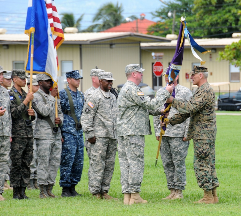 U. S. Army Col. Kirk C. Dorr assumes command of Joint Task Force- Bravo, at Soto Cano Air Base, Honduras by accepting the guidon from U. S. Marine Gen. John F. Kelly, the U.S. Southern Command commander June 23, 2014. Col. Dorr assumed command from U. S. Army Col. Thomas D. Boccardi. JTF-Bravo conducts a variety of missions in Central America from supporting U.S. Government operations to counter transnational crime to humanitarian assistance/disaster relief and building partner capacities.  (Photo by U. S. Air National Guard Capt. Steven Stubbs)