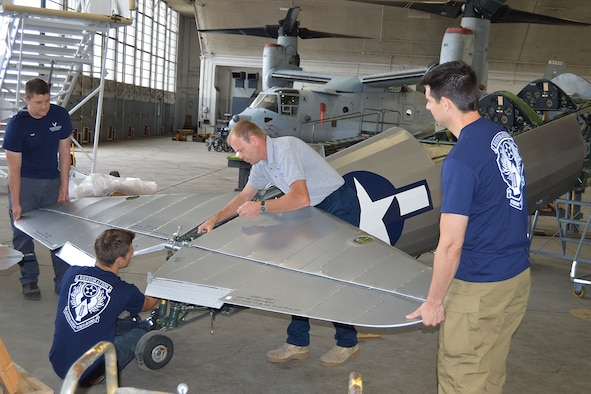 DAYTON, Ohio (06/2014) -- National Museum of the U.S. Air Force Restoration Specialists assemble the tail section of the Stearman PT-13D Kaydet. Plans call for the aircraft to be part of an expanded Tuskegee Airman exhibit in the World War II Gallery at the National Museum of the U.S. Air Force. (U.S. Air Force photo by Ken LaRock)
