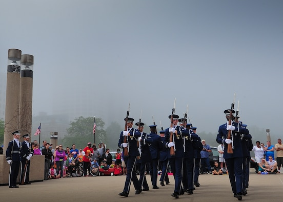 The U.S Air Force Drill Team marches into position at the Milwaukee War Memorial June 22, 2014. The Drill Team performed at the Milwaukee Air & Water Show June 21 and 22, and is on a nine-day, seven-city, 10-performance tour across Wisconsin, Minnesota, South Dakota, Wyoming, and Nebraska. (U.S. Air Force Photo/1st Lt. Nathan Wallin)