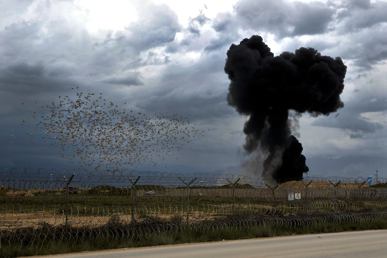 A National Air Cargo Boeing 747 airliner, with a seven-person crew and cargo consisting of five military vehicles, crashed shortly after takeoff from Bagram Airfield, Afghanistan, April 29, 2013. The aircraft erupted into flames near the end of the runway within the perimeter of the airfield, all seven crew members perished in the crash.  (U.S. Air Force photo/Senior Airman Chris Willis)