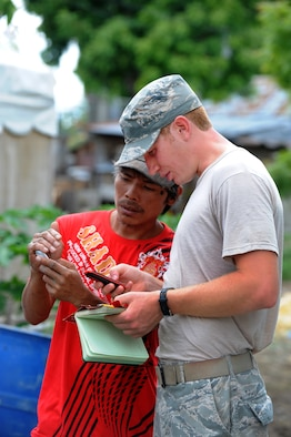 First Lt. Kory Carpenter coordinates with a local Philippine contractor June 18, 2014, at Buyong Elementary School in Barangay Maribago, Lapu-Lapu City, Philippines. Operation Pacific Unity is a bilateral Engineering Civic Action Program conducted in the Asia-Pacific region in collaboration with host nation military personnel. Carpenter was the Pacific Unity 14-6 project officer in charge. He and other Airmen from the 374th Civil Engineer Squadron, Yokota Air Base, Japan, spent 31 days building two classrooms and renovating utilities throughout the school. (U.S. Air Force photo/Staff Sgt. Amber E. N. Jacobs)
