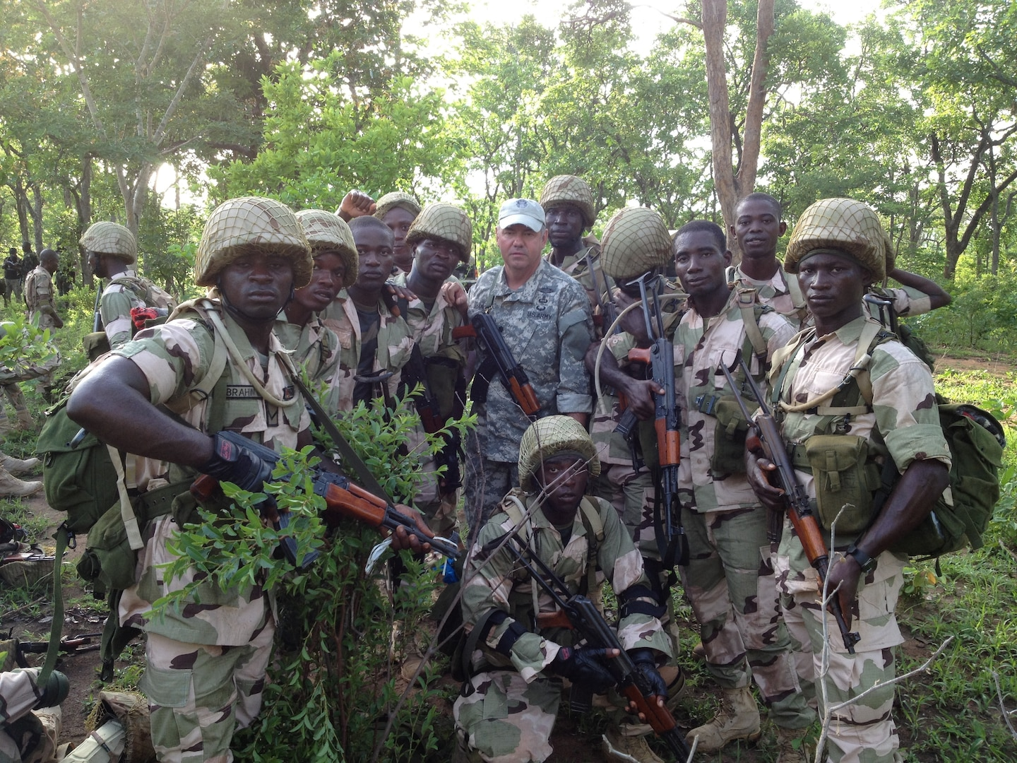 A California National Guard Special Forces soldier from Los Alamitos-based Special Operations Detachment-U.S. Northern Command and Company A, 5th Battalion, 19th Special Forces Group (Airborne), poses with Nigerian soldiers on May 31, 2014, during a training mission in Nigeria.