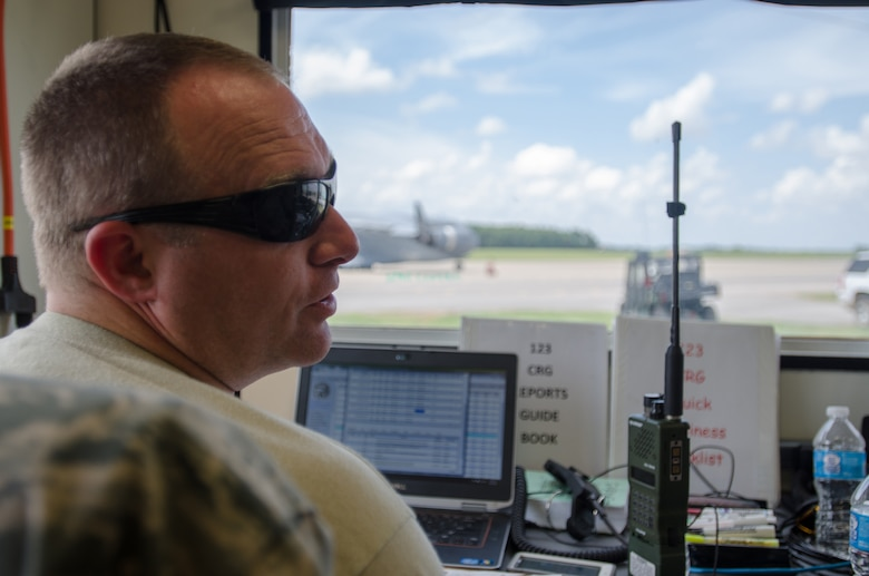 Tech. Sgt. Michael Skeens, command post controller for the Kentucky Air National Guard's 123rd Contingency Response Group, tracks aircraft on the airfield at Fort Campbell, Ky., June 18, 2014, during Capstone '14, a homeland earthquake-response exercise. The 123rd CRG joined forces with the U.S. Army's 688th Rapid Port Opening Element to operate a Joint Task Force-Port Opening here from June 16 to 19, 2014. (U.S. Air National Guard photo by Master Sgt. Phil Speck)