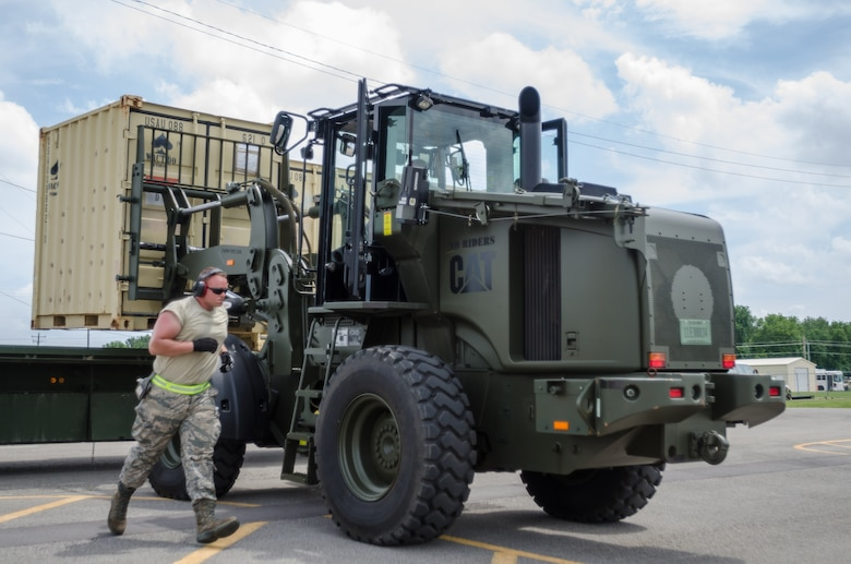 Airmen from the Kentucky Air National Guard's 123rd Contingency Response Group use a forklift to load cargo onto a flatbed truck during Capstone '14, a homeland earthquake-response exercise at Fort Campbell, Ky., on June 18, 2014. The 123rd CRG joined forces with the U.S. Army's 688th Rapid Port Opening Element to operate a Joint Task Force-Port Opening here from June 16 to 19, 2014. (U.S. Air National Guard photo by Master Sgt. Phil Speck)