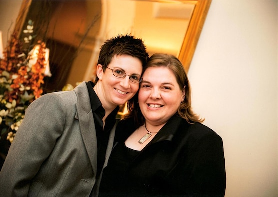 Master Sgt. Angela Caruso-Yahne, 34th Aeromedical Evacuation Squadron, Peterson Air Force Base, Colorado, (left) and her spouse, Mandy, pose for a photo at a friend's wedding. The two legally married July 2013, one month after the repeal of the Defense of Marriage Act and 14 years after their unofficial wedding. Approaching their sixth deployment together, the couple attended their first Yellow Ribbon event this year. (Courtesy photo)