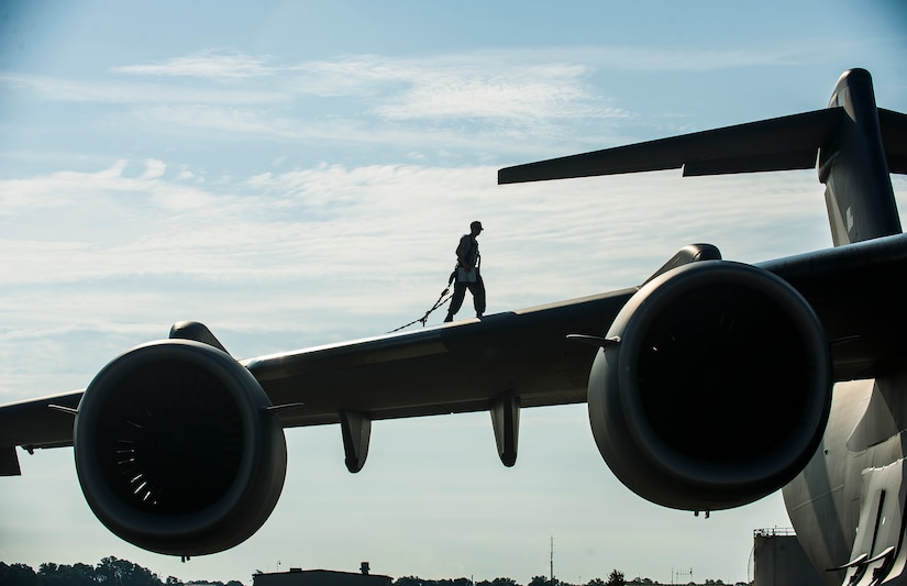Airman 1st Class Matt Sinclair, 437th Aircraft Maintenance Squadron crew chief, inspects a Globemaster III C-17 wing, June 24, 2014, at Joint Base Charleston, S.C. The maintainers perform daily checks and maintenance to ensure the aircraft are ready to fly. (U.S. Air Force photo/Senior Airman George Goslin)