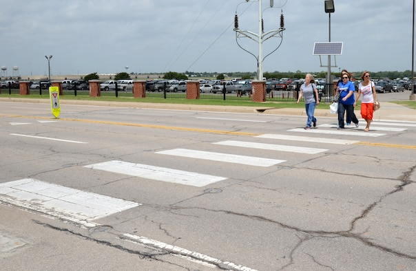 Many vehicle-pedestrian mishaps could be avoided if both the driver and the walker are paying attention. Pedestrians should always make eye contact with drivers before they enter the crosswalk. (Air Force photo by Kelly White)