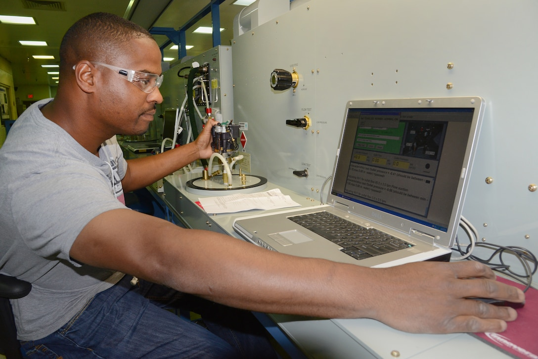 Jason Jenkins troubleshoots and runs tests on an 0393 oxygen regulator in the Air Force's only Oxygen Maintenance Depot. (Air Force photo by Kelly White)