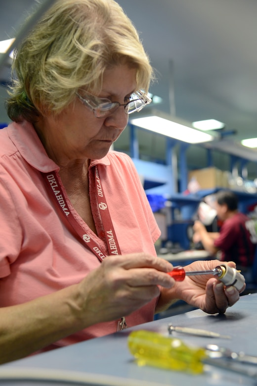 Like a complex puzzle, Cathy Ross, an instrument mechanic, assembles an 0393 oxygen regulator. This particular piece of equipment is made up of approximately 200 parts. (Air Force photo by Kelly White)