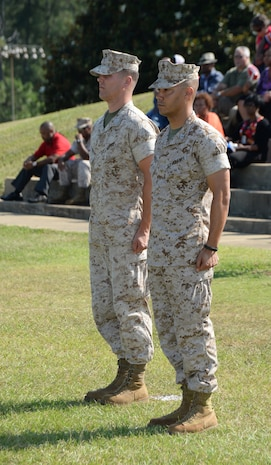 Capt. Justin Jacobs (left), former commanding officer of Headquarters and Support Company, Marine Corps Logistics Base Albany, stands with Capt. Kenneth Barber in front of the company's Marines during the company change of command ceremony at Boyett Park, June 19. The ceremony signified Barber taking the company's helm.