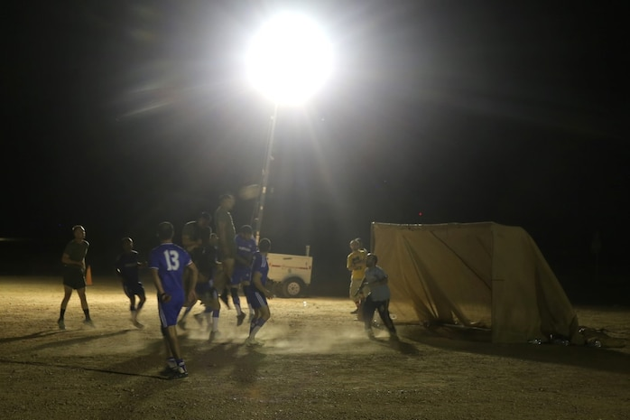"A Marine with ""Suicide"" Charley Company, 1st Battalion, 7th Marine Regiment, attempts to head the ball into the goal during the championship game in the Dwyer World Cup aboard Camp Dwyer, Helmand province, Afghanistan, June 22, 2014. A total of four teams participated in the tournament to include Team America, Afghanistan, Jordan and the World Team (consisting of contractors on the camp). The Marines ultimately defeated the World Team during the final game and were the champions of the tournament. (U.S. Marine Corps photo by Cpl. Joseph Scanlan / released)"