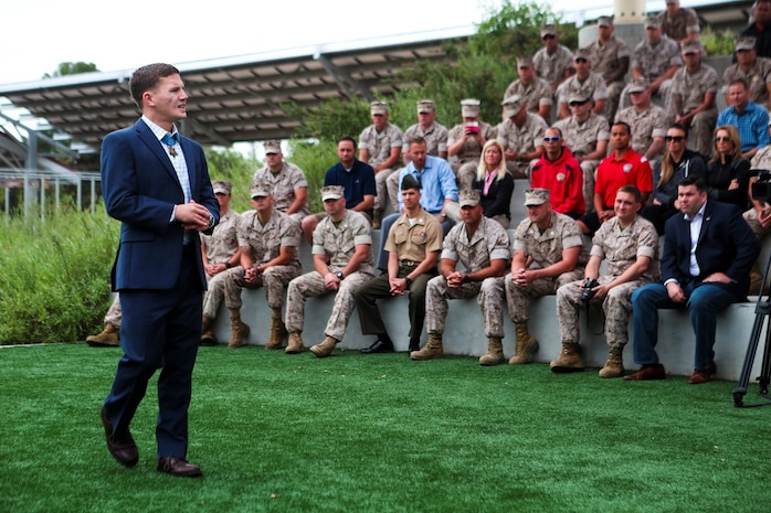 """Medal of Honor recipient Cpl. William """"Kyle"""" Carpenter addresses service members with Warrior Wounded Battalion West during a visit to Camp Pendleton, Calif., June 23, 2014. During the visit, Carpenter also spoke to service members at the base theater. Carpenter earned the nation's highest military award for his actions in Helmand province, Afghanistan, in November 2010. He saved another Marine's life by shielding him from a grenade blast during an enemy attack."""