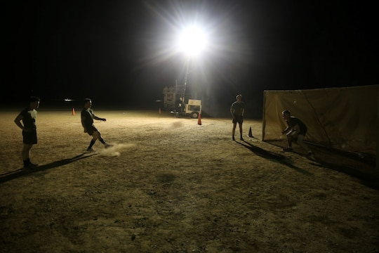 "Marines with ""Suicide"" Charley Company, 1st Battalion, 7th Marine Regiment, conduct shooting drills prior to their first match in the Dwyer World Cup aboard Camp Dwyer, Helmand province, Afghanistan, June 21, 2014. A total of four teams participated in the tournament to include Team America, Afghanistan, Jordan and the World Team (consisting of contractors on the camp). The Marines ultimately defeated the World Team during the final game and were the champions of the tournament.  (U.S. Marine Corps photo by Cpl. Joseph Scanlan / released)"