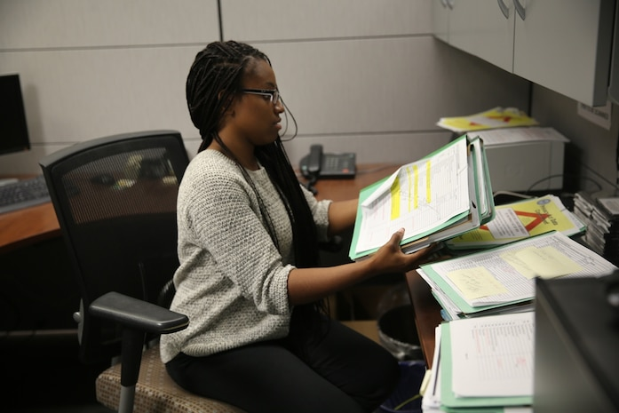 Girl filing doc: Taneshi Noel, student clerk at Marine Corps Logistics Base Barstow's Human Resource Office, files documents, June 23. New summer hires here are gaining on the job experience for future careers.