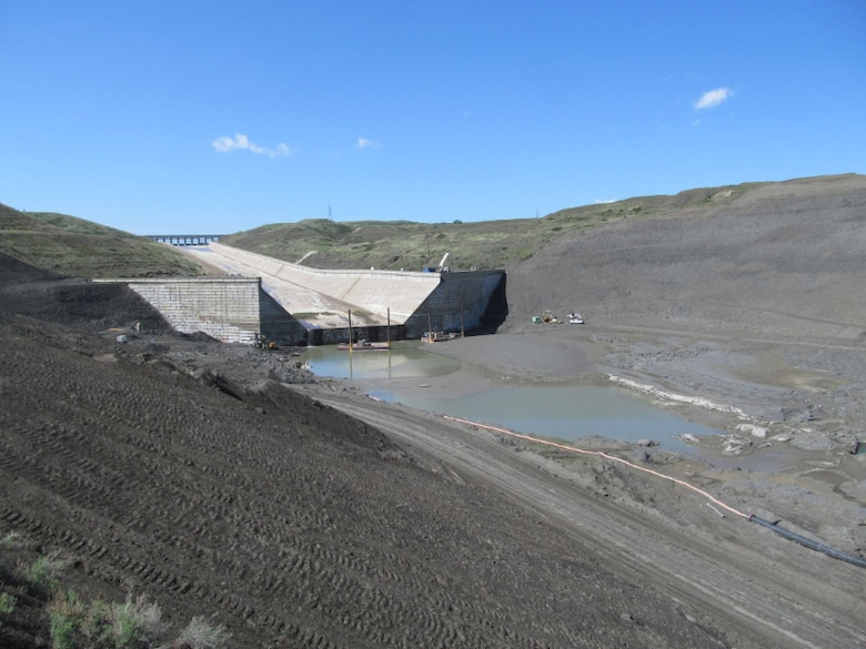 Bottom of the Fort Peck spillway. Contractors are working on the plunge pool at the end of the spillway installing horizontal anchors in the downstream concrete wall.