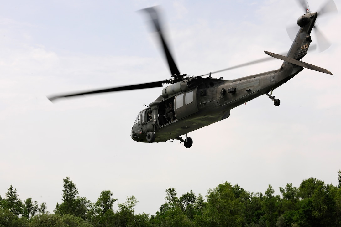 A UH-60 Black Hawk helicopter approaches the landing zone during a combat search and rescue training mission, June 24, 2014, at Cellina Meduna training ground near Maniago, Italy. Establishing a good relationship with other branches of the U.S. military helps mitigate risk and confusion in the event of a real-world situation requiring military intervention and assistance. (U.S. Air Force photo/Airman 1st Class Ryan Conroy)