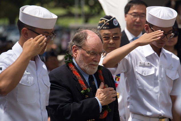 Hawaii governor Neil Abercrombie (center) places his hand on his heart as two Republic of Korea Navy cadets salute after laying a wreath at the base of the National Memorial Cemetery of the Pacific (Punchbowl) during the 64th annual Korean War memorial ceremony, June 25, 2014. The ceremony commemorated U.S. and Republic of Korea veterans, both living and dead, who fought for the freedom of South Korea, and guests in attendance laid wreaths at the base of the memorial to honor those who gave their lives. (U.S. Marine Corps photo by Cpl. Matthew J. Bragg)