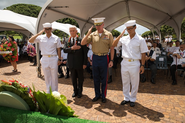 Col. Jeffrey J. Davis (second from right), chief of staff, salutes the wreaths laid at the base of the National Memorial Cemetery of the Pacific (Punchbowl) during the 64th annual Korean War memorial ceremony, June 25, 2014. The ceremony commemorated U.S. and Republic of Korea veterans, both living and dead, who fought for the freedom of South Korea, and guests in attendance laid wreaths at the base of the memorial to honor those who gave their lives. (U.S. Marine Corps photo by Cpl. Matthew J. Bragg)