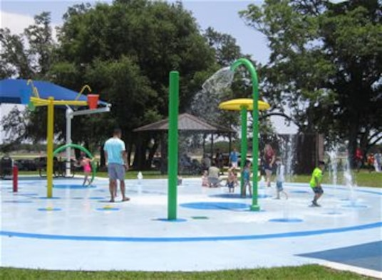 Keesler children play at the Splash Pad at the Marina, June 18. The splash pad is an eco-friendly addition, as it is a fresh water system that utilizes water from Keesler's water supply and drains into the Bay Breeze Golf Course reservoir where it is then used for irrigating the golf course. (Courtesy photo by Lisa Campbell)