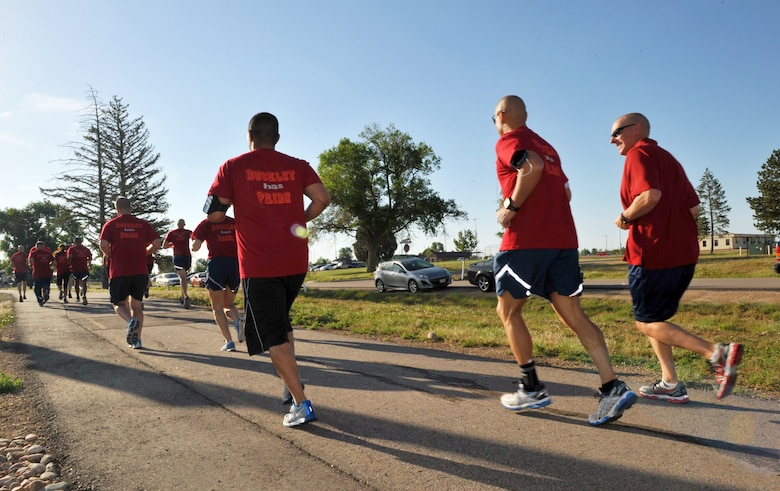 Participants of the Pride Month 5k fun run take off at the beginning of the run June 25, 2014, at the all-purpose field on Buckley Air Force Base, Colo. Team Buckley hosted the run as a way to support the lesbian, gay, bisexual and transgender month and raise HIV awareness. (U.S. Air Force photo by Airman Emily E. Amyotte/Released)