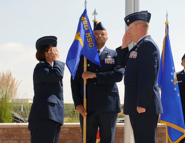 Maj. Jeremy Morrill, right, salutes Col. Rose Jourdan, left, 460th Mission Support Group commander, after relinquishing his command of the 460th Contracting Flight during the 460th CONF Change of Command Ceremony June 24, 2014, at the 460th Space Wing headquarters building on Buckley Air Force Base, Colo. Morrill served as the 460th CONF commander since July 2012, where he successfully led his flight through many challenges. (U.S. Air Force photo by Airman 1st Class Samantha Saulsbury/Released)