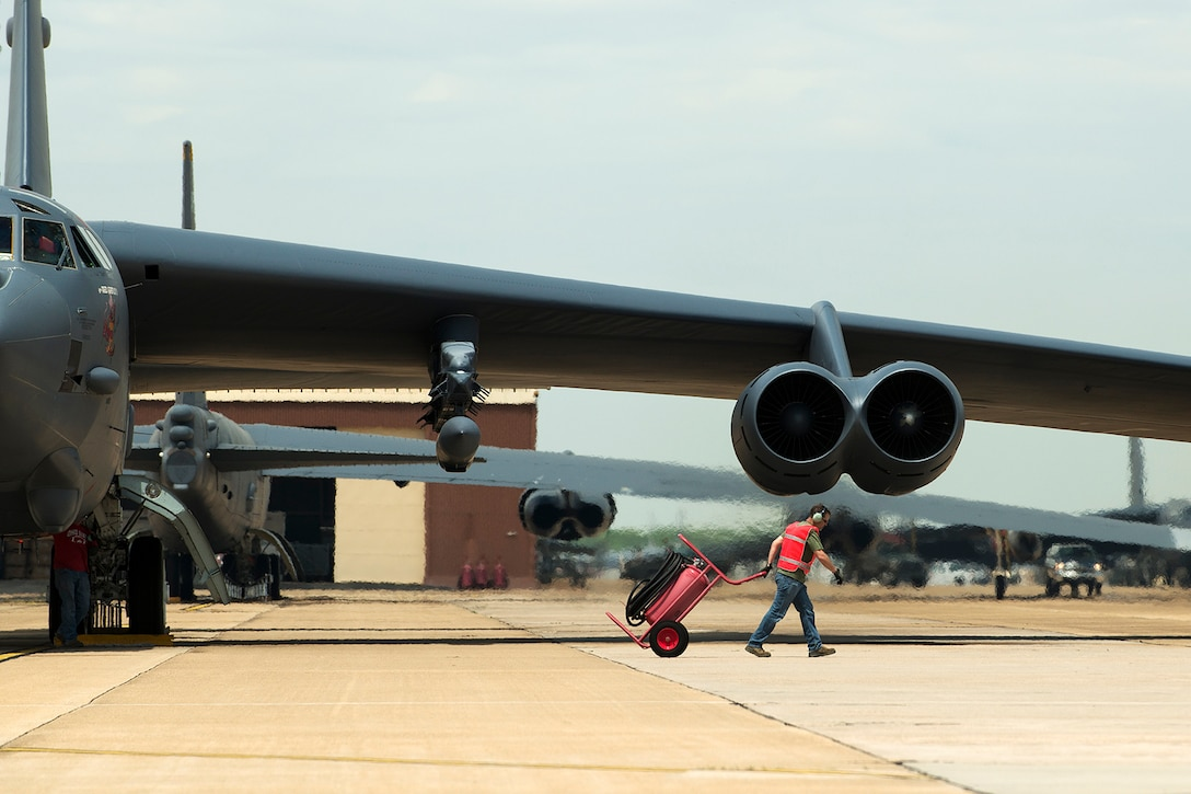 A 307th Aircraft Maintenance Squadron crewchief prepares to launch a B-52H Stratofortress on its first mission carrying the AN/ASQ-236 Radar Pod, April 21, 2014, Barksdale Air Force Base, Louisiana. The 307th Bomb Wing is testing the pod, which will give B-52s the ability to precisely geo-locate points of interest and conduct surveillance activities day or night, in adverse weather conditions. (U.S. Air Force photo by Master Sgt. Greg Steele/Released)
