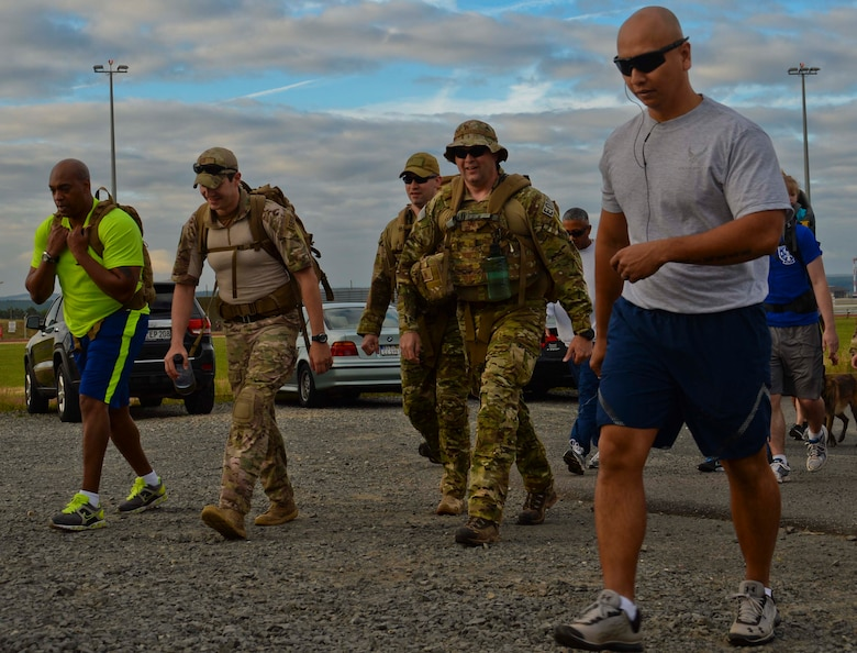 Participants run in the Jog for Joe Memorial 5K at Spangdahlem Air Base, Germany, June 20, 2014. Many run participants wore heavy explosive ordnance disposal suits or firefighter gear as part of the event to commemorate the loss of Staff Sgt. Joseph Hamski, formerly assigned to the 52nd Civil Engineer Squadron EOD flight, who was killed in support of Operation Enduring Freedom May 26, 2011. (U.S. Air Force photo by Staff Sgt. Joe W. McFadden/Released)