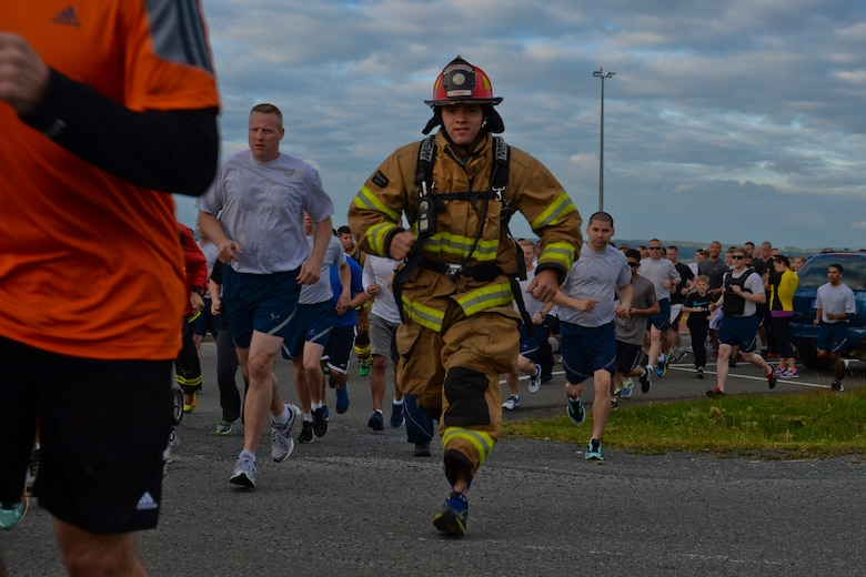 U.S. Air Force Staff Sgt. Bryan Souder, a firefighter assigned to the 52nd Civil Engineer Squadron and Bellevue, Neb., native, runs beside fellow participants in the Jog for Joe Memorial 5K at the base track at Spangdahlem Air Base, Germany, June 20, 2014. Nearly 500 Airmen and their families participated in the run to commemorate the loss of Staff Sgt. Joseph Hamski, a 52nd CES explosive ordnance disposal flight technician, who was killed in support of Operation Enduring Freedom May 26, 2011. (U.S. Air Force photo by Staff Sgt. Joe W. McFadden/Released)