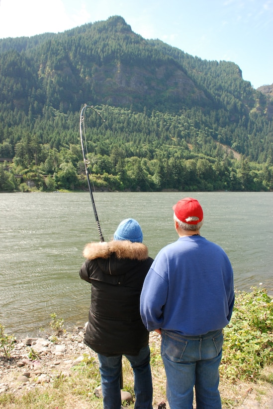 A couple try their luck fishing at the North Shore Recreation Area at Bonneville Lock and Dam. The North Shore Recreation Area is a popular fishing spot on the Washington side of the Columbia River.