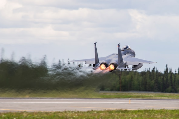 An F-15 Eagle takes off during Red Flag-Alaska 14-2, June 16, 2014, on Eielson Air Force Base, Alaska. Red Flag-Alaska is a series of Pacific Air Forces commander-directed field training exercises for U.S. and partner nation forces, providing combined offensive counter-air, interdiction, close air support, and large force employment training in a simulated combat environment. The aircraft is assigned to the 159th Fighter Squadron, Florida Air National Guard. (U.S. Air Force photo/Senior Airman Joshua Turner)