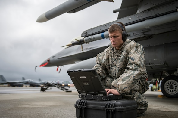 Staff Sgt. Zackery Coder checks computer data during Red Flag-Alaska 14-2, June 19, 2014, on Eielson Air Force Base, Alaska. Coder ensured the F-16 Fighting Falcon was ready for the next sortie. He is a crew chief with the 36th Aircraft Maintenance Unit, Osan Air Base, South Korea. (U.S. Air Force photo/Senior Airman Peter Reft)