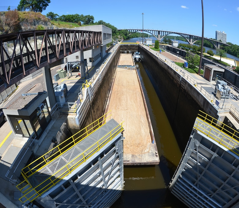 A downbound tow locks through Lock and Dam 1