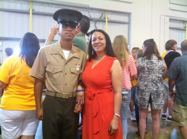 Pvt. Kelvin Contreras, North Philadelphia native, and his mother, Ana, take a moment to pose for a photo after the family day ceremony aboard Marine Corps Recruit Depot Parris Island, S.C, recently.