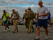 Participants run in the Jog for Joe Memorial 5K June 20, 2014, at Spangdahlem Air Base, Germany. Many run participants wore heavy explosive ordnance disposal suits or firefighter gear as part of the event to commemorate the loss of Staff Sgt. Joseph Hamski, formerly assigned to the 52nd Civil Engineer Squadron EOD flight, who was killed in support of Operation Enduring Freedom May 26, 2011. (U.S. Air Force photo/Staff Sgt. Joe W. McFadden)