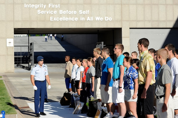 """Basic cadets from the Class of 2018 are addressed by cadet cadre as they stand in formation June 26, 2014, on """"the footsteps"""" outside of the Core Values Ramp at the U.S. Air Force Academy, Colo. Basic cadets spent their first day getting a military haircut and their uniforms, donating blood, meeting their cadre, and receiving a taste of Academy life. (U.S. Air Force Photo/Sarah Chambers)"""