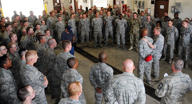 Chief Master Sgt. of the Air Force James A. Cody introduces Master Sgt. Andre Davis to a group of Airmen assigned to the 5th Combat Communications Group, June 25, 2014, during his visit to Robins Air Force Base, Ga. Davis, with the Air National Guard's 203rd RED HORSE Squadron, was one of the Air Force's 12 Outstanding Airmen of the Year for 2013 and accompanied Cody during his tour of Robins AFB. (U.S. Air Force photo/Senior Master Sgt. Jill LaVoie)