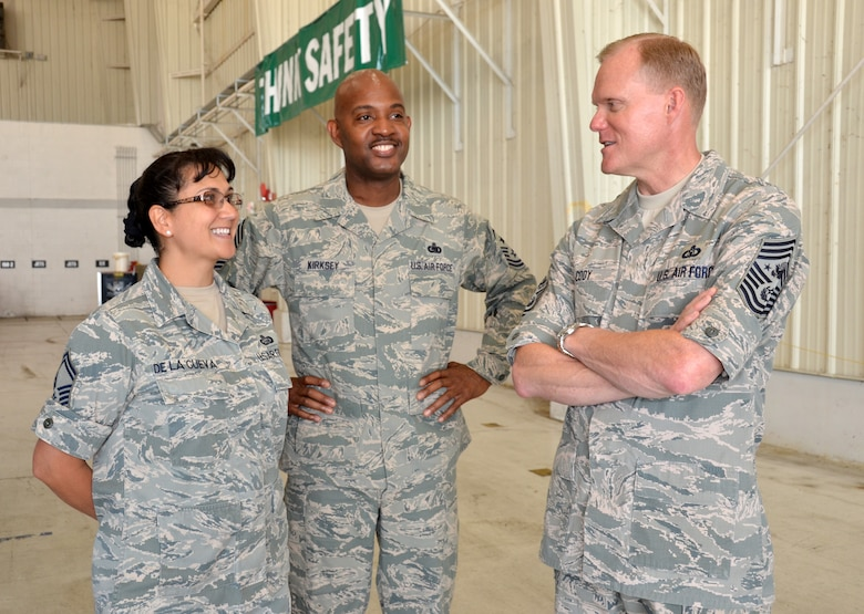 Senior Master Sgt. Teresa De La Cueva, left, speaks with Chief Master Sgt. of the Air Force James A. Cody, right, and Chief Master Sgt. Cameron Kirksey June 25, 2014, during Cody's visit to Robins Air Force Base, Ga. Kirksey is the Air Force Reserve Command command chief and De La Cueva is with the AFRC commander's action group. (U.S. Air Force photo/Staff Sgt. Kelly Goonan)